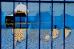 Wonder Holes (Claire_Sambrook) Tags: uk blue sand hampshire holes beachvolleyball portsmouth volleyballcourt southsea holeinfence clairesambrook welshphotographer createup clairesambrookphotographer
