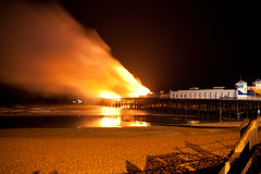 Hastings Pier fire burns (AndyWilson) Tags: fire pier sad sony hastings alpha hastingspier a700 18250 sadsadsad sadsad ievenusedatripod