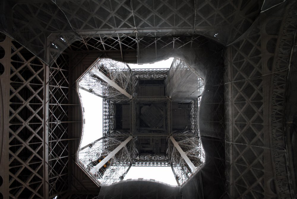 looking up from the bottom of the eiffel tower