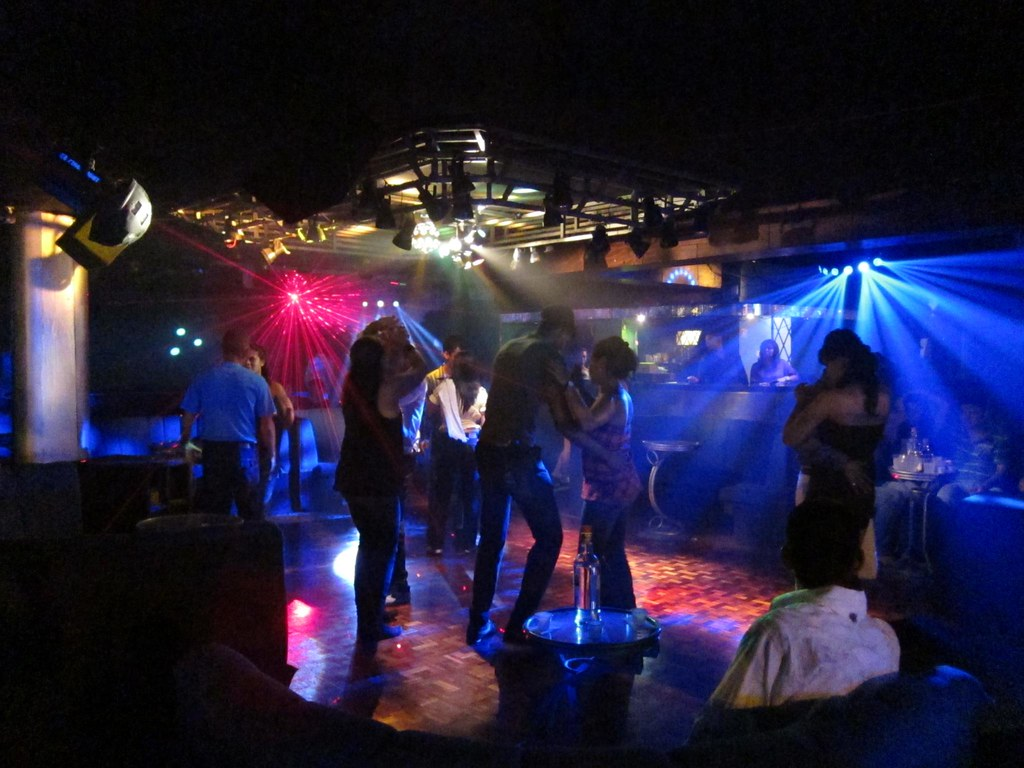 On the 2nd floor of the Latin Palace, early on a Saturday night, the dance floor is still warming up.
