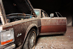 Smashed (imprint777) Tags: old abandoned broken car canon newjersey nj rusty cadillac vehicle flattire motor smashed destroyed caddy ruined xsi northjersey brokenwindshield cadillacseville canonxsi