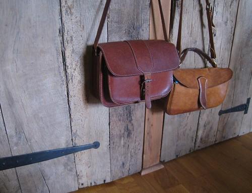 Vintage satchels against the cupboard door