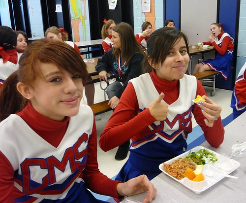 Illinois School District 300 cheerleaders eat a nutritious lunch just prior to a ceremony to celebrate Golfview Elementary School's receipt of a USDA Healthier School award.