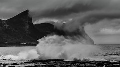 Storm brewing (AndreDiener) Tags: waves rocks mountains sea ocean crashingwaves blackandwhite monochrome landscape clouds rain storm andre water slowshutterspeeds coast coastline stormyseas