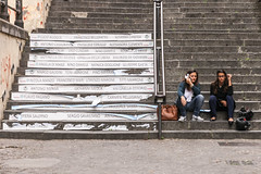 (Zioluc) Tags: luciobeltrami napoli naples street stairs two girls sitting advertising elections