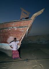 Man in front of a dhow in Masirah Island, Oman (Eric Lafforgue) Tags: wood boat ile arabia bateau oman bois dhow dow omn  sultanate arabie  traveldestination sultanat arabianpeninsula om  omo umman omaan   masirahisland   omna omanas umn penisulearabique 4459356