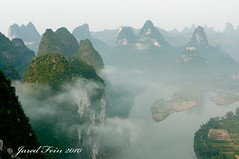 Surreal (SewerDoc (200 Explores)) Tags: china cliff mist mountain mountains nature clouds sunrise river landscape asia guilin surreal peak explore limestone mystical orient guangxi guangxiprovince xingping blueribbonwinner riverli flickrexplore explored mywinners karstmountains diamondclassphotographer flickrdiamond sewerdoc rubyphotographer 100commentgroup jaredfein