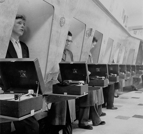 hmv 363 Oxford Street, London - Customers using listening booths 1950s / hmv getcloser