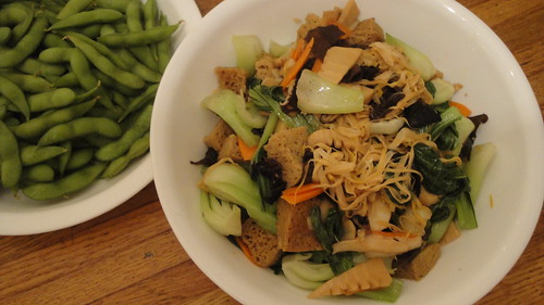 Gluten with vegetables (紅燒烤麩) with edamame in background