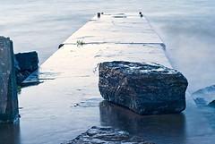 Rock on Lake Ontario Pier (otterman51) Tags: ocean longexposure blue sunset sea mist lake seascape water rock landscape evening pier long exposure waves windy nightdock