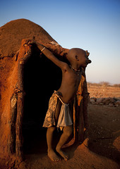 Himba house at sunset - Namibia (Eric Lafforgue) Tags: africa boy house kid child african culture tribal safari hut afrika tribe ethnic namibia tribo himba angola afrique hutte namibian ethnology tribu nomadic namibie kaokoland tribus namibe bantou namibi namiibia 0842 ethnie pastoralpeople himbas cuene kuene     namibya namibio    bantoue thnicgroup