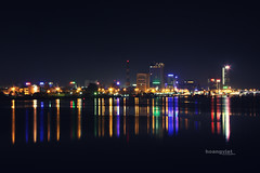 Danang (Hoang Viet) Tags: lighting city bridge light panorama house reflection building water skyline night river landscape view vietnam sparkle viet reflect nightlife spark sparkling danang cityview hanriver panoramicview