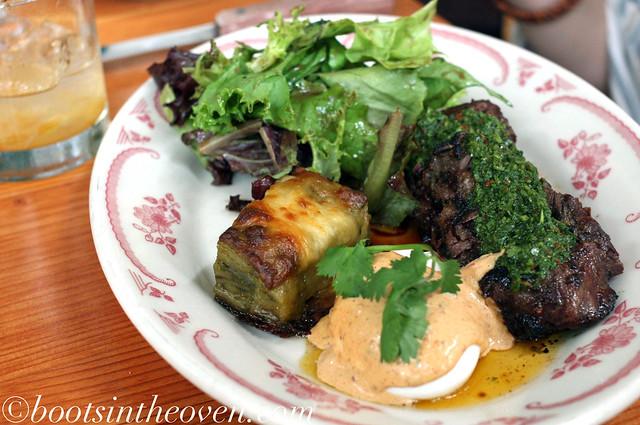 Huevos y Carne Asada (wood-grilled skirt steak, poached eggs, chipotle mayo, poblano gratin)
