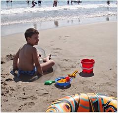 At the Black Sea (CameliaTWU) Tags: boy beach kid bucket sand waves romania blacksea neptun sandhole