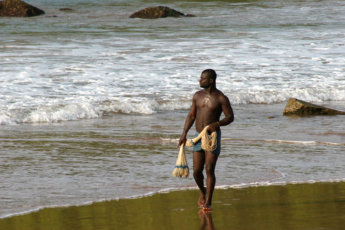 A local fisherman on the beach in Ghana. / Nisa + Ulli Maier
