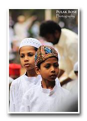 Eid Prayer (pulak_bose) Tags: street people india canon kid worship muslim prayer bangalore eid mosque masjid allah bws jama mubarak 500d ramzan eidulfitr idulfitr sep2010 bwseidshoot11sep2010