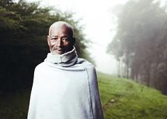 The Elder (Jeremy Snell) Tags: africa mist green grass beard robe farm african 28mm mount elder ethiopia 18 entoto