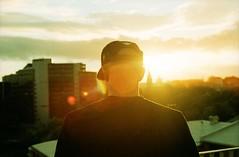 dreamon (Benjamin Skanke) Tags: city sunset portrait orange sun film rooftop hat oslo norway clouds analog 50mm norge xpro md cross minolta kodak bokeh f14 14 grain slide 11 x filter flare pro tungsten expired ektachrome processed canoscan xd 85b dreamon rokkor 320t