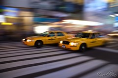 NYC - Fast & Furious Yellow Cabs (GlobeTrotter 2000) Tags: nyc summer vacation urban usa motion apple yellow skyline night speed square big action manhattan cab taxi united fast times states panning furious gettyvacation2010