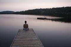 Meditation (Jonathan!) Tags: lake canada pier quebec montreal meditation pontoon gettyvacation2010 lurentians