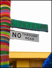 Pole Sweater (suavehouse113) Tags: sign sweater knitting colorful stripes streetsign australia homemade jumper knitted multicolored fremantle freo westernaustralia striped 2010 philscamera artsandcrafts nothroughroad guerillaknitting southfremantle guerrillaknitting hulbertstreet yarnbombing hulbertstreetsustainabilityfiesta