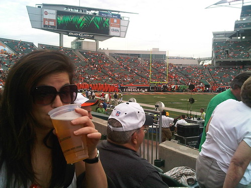 Leyla at Bengals Game - hiding behind a beer