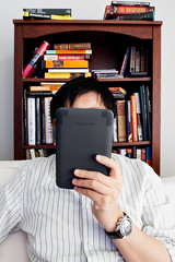Lazy day reading with the new Kindle by Malenkov in Exile, on Flickr