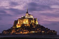 Mont Saint Michel at dusk (seryani) Tags: longexposure sunset sea mountain france church water abbey night canon river island bay coast mar twilight europe cathedral dusk magic tide ile bretagne unescoworldheritagesite unesco mount bluehour lowtide stmichel benedictine soir isle normandy nuit isla nocturne canonef2470mmf28lusm 2470l nit anochecer hightide montstmichel montsaintmichel stmichaelsmount saintmichel marea saintmichaelsmount couesnon nocturnes lemontsaintmichel 2470 noctambule photographyrocks mywinners flickraward bahie canoneos5dmarkii goldstaraward 5dmarkii bretana