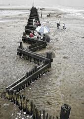 DSCN0343 British At Play 1Edit A4 Web (Kett's Photopaedia) Tags: holiday beach wet umbrella play bank british groyne