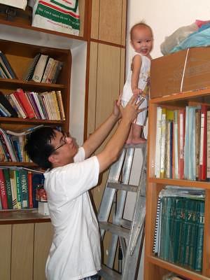 Justin climbs up a ladder