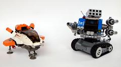 Swoosher -vs- Battle Machine (Buster) Tags: blue orange tank lego jet mecha vireo starfighter battlemachine swoosher deskcrawler