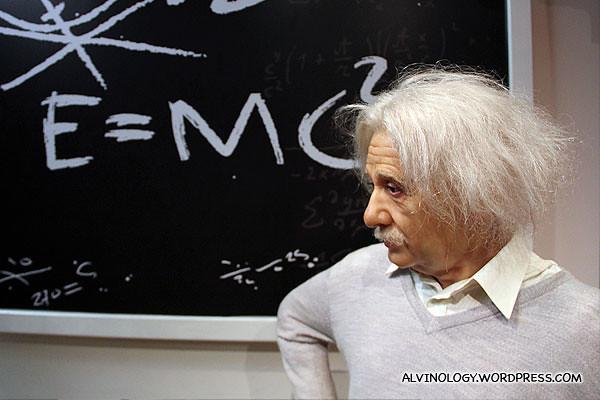 Albert Einstein with his famouse e = mc2