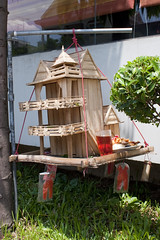 Mereng Kung Veal Spirit House (Keith Kelly) Tags: wood red food house religious toys construction model cambodia southeastasia cambodian khmer candy display drink spirit buddhist ghost capital honor bamboo clothes holy elf ancestor figure sacred offering phno