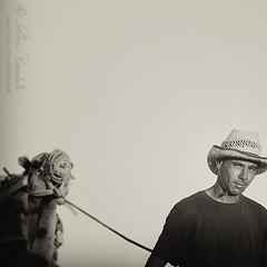 the camel man () Tags: street man sahara andy look hat photography eyes strada alone desert andrea candid straw stranger andrew sguardo uomo camel solo fotografia occhio paglia cappello deserto cammello sconosciuto benedetti