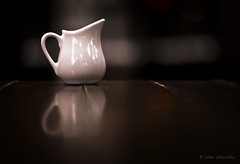 caf au lait (helen sotiriadis) Tags: wood brown white macro reflection closeup canon table milk published dof bokeh athens depthoffield pitcher canonef50mmf14usm kefalari kifisia canoneos40d