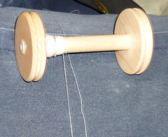 Merino singles on the bobbin next to the commercial sewing thread