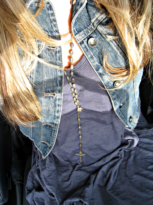 rosary beads worn as a necklace+denim jacket