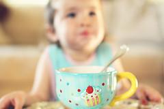 {morning cereal} (tolly p) Tags: blue breakfast eating bib daughter cereal spoon sleepy cupcake mug tray