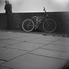 homeless and bicycle (triangle triangles) Tags: bw london 120 film bicycle thames analog mediumformat square lomo lomography homeless 120film diana dianaf triangletriangles romankulikov