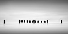 five and nine (Jeff Gaydash) Tags: longexposure blackandwhite chicago water seascapes 21 symmetry lakemichigan greatlakes zen pilings lakescapes doublesquare nd110