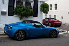 The Future? (Alex Penfold) Tags: blue red green london cars alex sports car sport electric canon photography photo cool power image duo awesome picture fast super exotic photograph supercar exotica tesla 2010 combo powered roadster penfold 450d hpyer