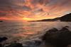 Crashing waves over sunset (ChR!s H@rR!0t) Tags: sunset red sea sand rocks waves penang