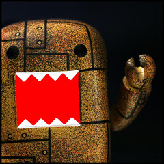 THE WRATH OF DOMO (1crzqbn~away) Tags: red color macro square bokeh naturallight anger domo 7d wrath 326 project365 macromondays the7deadlysins shuttersisters365 fadedblurred3652010 1crzqbn thewrathofdomo qeecollectiblefigure