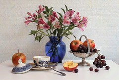 This Summer Day (Esther Spektor - Thanks for 12+millions views..) Tags: stilllife naturemorte bodegon naturezamorta stilleben haturamorta composition creativephotography artisticphoto arrangement tabletop summer bouquet flowers alstromeria food fruit apple grape cluster vase basket sugarbowl plate spoon lid slice class metal availablelight reflection pattern white red green pink burgundy silver blue cobalt estherspektor canon