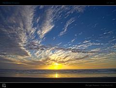 The Light Fantastic (tomraven) Tags: ocean light sunset sea sky sun reflection beach clouds fantastic surf hdr fbdg tomraven aravenimage passiondéclic q32010