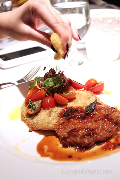 Breaded veal scallopine pan fried in butter glace with veal jus, cherry tomato salsa & lemon wedge