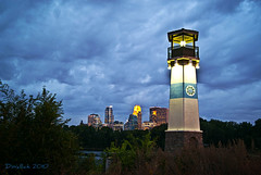 Stormy Lighthouse (Doug Wallick) Tags: lighthouse tower minnesota skyline river mississippi island cloudy minneapolis stormy boom wellsfargo picnik lightroom ids capella a230