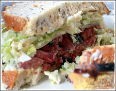 Pastrami sandwich with coleslaw on the inside.