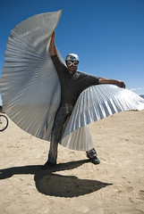 Burning Man 2010 (Chicago_Tim) Tags: city man black guy art festival rock silver wings desert nevada burningman blackrockcity burning metropolis 2010