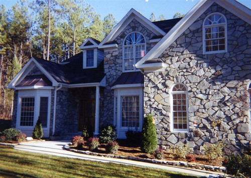 natural stone veneer using non-traditional stucco-type stone and a masonry method developed by Jeff Behringer in the 1990s
